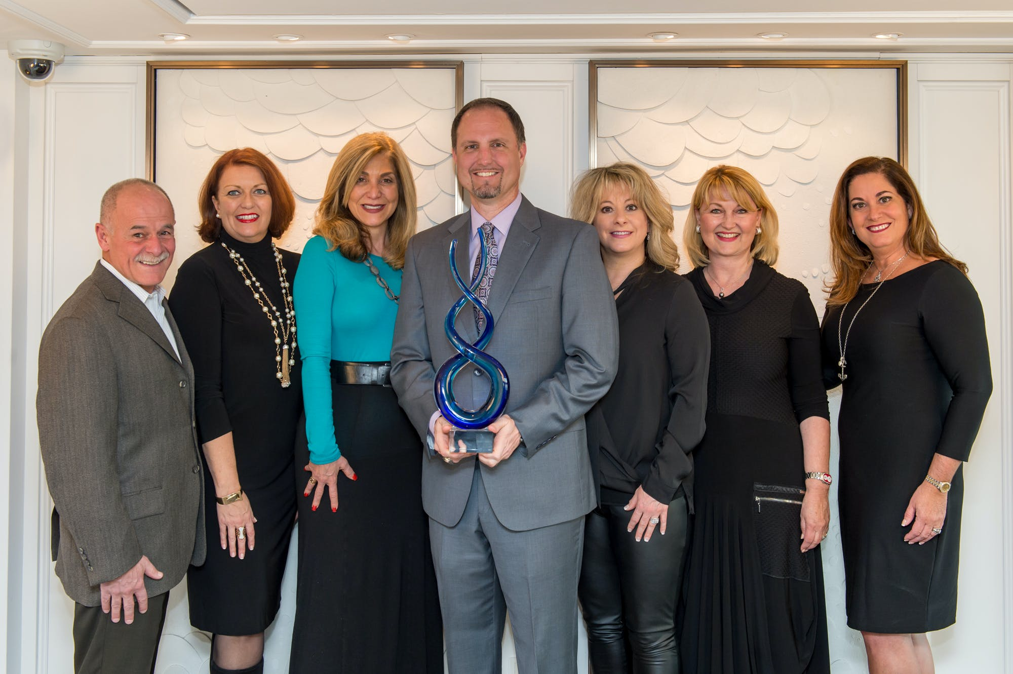 Ryan Hansen, President of Cruise Insider (center) with Crystal's Executive Team & Edie Rodriguez, Crystal's President & CEO